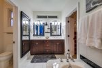 Master Bathroom with open air walk in shower, dual vanity and soaking tub
