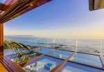 Oceanfront lounges on glass terrace