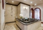 Walk-in stone shower and soaking tub