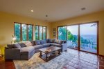 Family room with gas fireplace, stunning views, and flat-screen TV