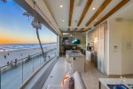 Floor to ceiling retractable beachfront windows