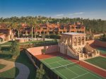 Tennis courts in the foreground and Villas in the background