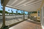 Beachfront patio with seating and shade