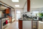 The kitchen features high end appliances and a built-in wine chiller