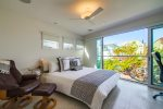 Master suite features king bed and ceiling fan