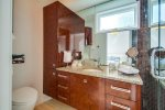 Queen suite bathroom with glass-tiled walk-in shower
