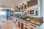 Stone counters and glass backsplash