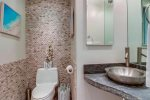 Powder room with stone accent wall
