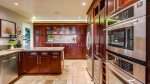 Gourmet kitchen with double ovens and wine fridge