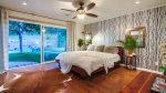 Master bedroom  with hardwood floors and pool access