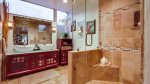Master Bathroom - spa like with custom stone work and seamless glass shower