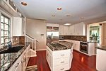 Granite counters and stainless appliances accent this upgraded kitchen