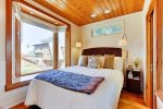 Queen bed with ocean views and a flat screen