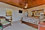 Master Suite features plank wood ceiling, flat-screen TV and ceiling fan