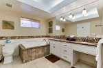 The Master Bath features a soaking tub and dual sink vanity