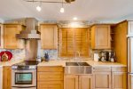 This kitchen features solid hardwood cabinetry and stainless appliances