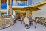 Patio with outdoor dining and built in gas BBQ