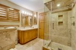 The master bathroom features a walk-in shower