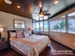 Master Suite in Villa 1 with water views and king size bed