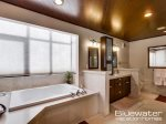 The Master Bath includes a jetted tub and walk in shower