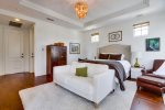 Master Suite with sofa and hardwood flooring