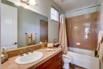 En-suite Bath in Bedroom II with a tub / shower combination