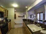 Updated kitchen with granite tile counter tops
