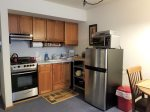 Fully equipped kitchen w/ rolling island - larger refrigerator - dishwasher