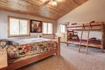 Eagle Trail Lodge bedroom with a queen and bunk beds.