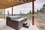 Eagle Trail Lodge deck with hot tub.