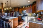 Kitchen and breakfast bar with granite counter tops.