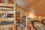 Bigfoot Bungalow loft with bunk beds and a full bed.
