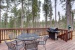 Bigfoot Bungalow deck with propane grill and eating area.