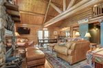 Bear Butte Gulch Lodge  with wood burning fireplace and leather furniture.
