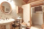 Bear Butte Gulch Lodge  with shower in the bathroom..
