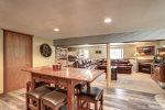 Big Jim`s Hideaway dining area and living room with wood burning fireplace.