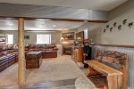 Big Jim`s Hideaway downstairs living room with wood burning fireplace.