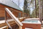 Big Jim`s Hideaway back deck with hot tub.