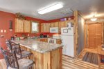 B ig Jim`s Hideaway modern kitchen with hickory cabinets.