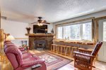 Big Jim`s Hideaway living room with wood burning fireplace.