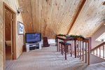 Knotty Pine Chalet loft with big screen TV.