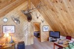 Knotty Pine Chalet with Elk and Deer mounts.