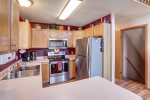 Knotty Pine Chalet kitchen with stainless steel appliances.