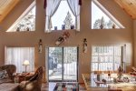 Knotty Pine Chalet with lots of windows and forest views.