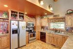 Kitchen with stainless steel appliances and dishwasher