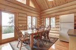 Dakota log Cabin dining room with vaulted ceilings and view.