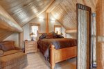 Dakota log Cabin upstairs bedroom with queen.
