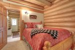 Dakota log Cabin bedroom with queen.