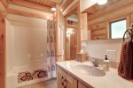 Dakota log Cabin bath with combo shower/tub.