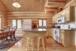 Dakota log Cabin kitchen with full log interior.